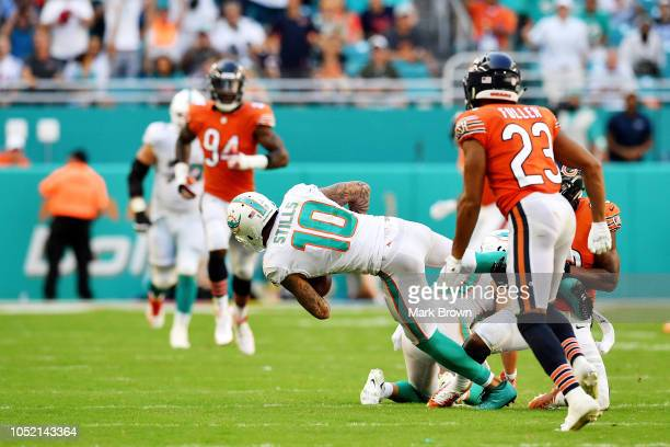 Kenny Stills of the Miami Dolphins completes a pass against the defense Adrian Amos and Kyle Fuller of the Chicago Bears at Hard Rock Stadium on...