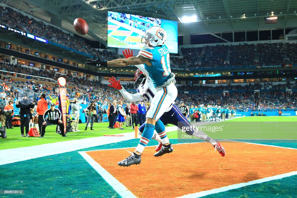 Kenny Stills #10 of the Miami Dolphins fails to make the catch against the New England Patriots during the first quarter at Hard Rock Stadium on December 11, 2017 in Miami Gardens, Florida.