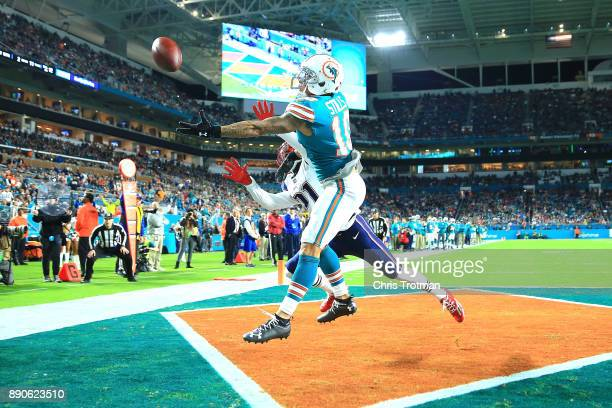 Kenny Stills of the Miami Dolphins fails to make the catch against the New England Patriots during the first quarter at Hard Rock Stadium on December...