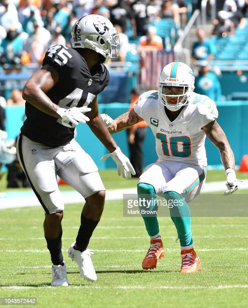 Kenny Stills of the Miami Dolphins in action against Dominique RodgersCromartie of the Oakland Raiders during the game between the Miami Dolphins and...