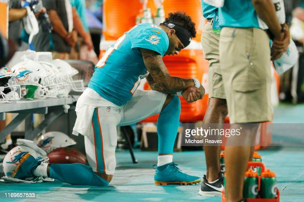 Kenny Stills of the Miami Dolphins kneels during the playing of the national anthem prior to the preseason game against the Jacksonville Jaguars at...