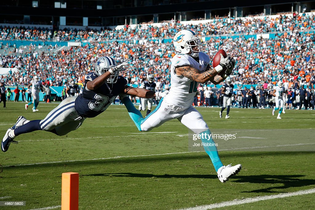 Kenny Stills #10 of the Miami Dolphins makes a 29-yard touchdown reception against Byron Jones #31 of the Dallas Cowboys in the third quarter of the game at Sun Life Stadium on November 22, 2015 in Miami Gardens, Florida.