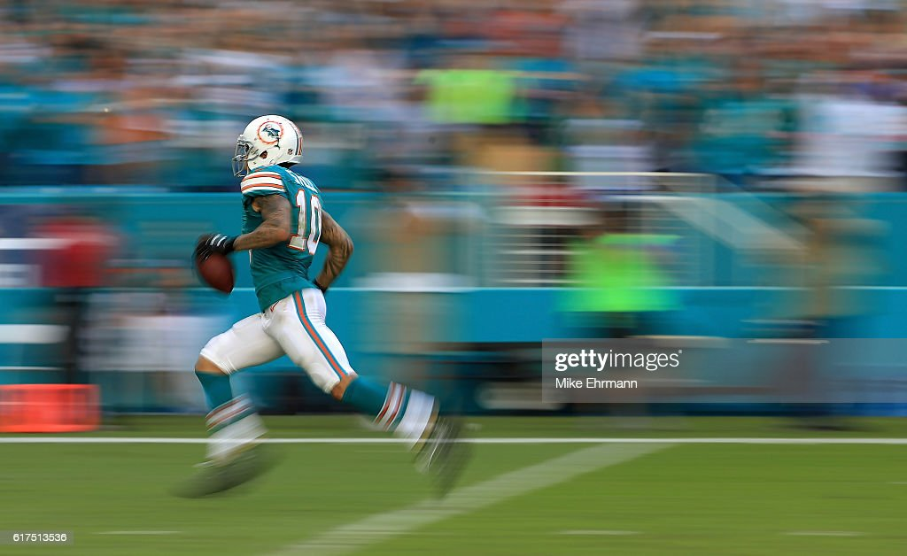 Kenny Stills #10 of the Miami Dolphins rushes for a touchdown during a game against the Buffalo Bills at Hard Rock Stadium on October 23, 2016 in Miami Gardens, Florida.