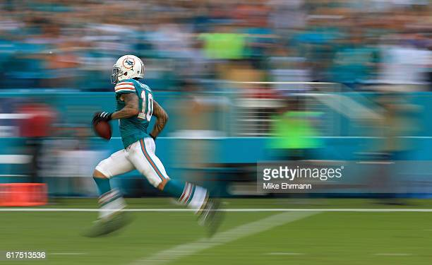 Kenny Stills of the Miami Dolphins rushes for a touchdown during a game against the Buffalo Bills at Hard Rock Stadium on October 23, 2016 in Miami...