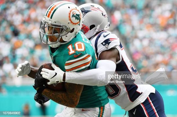 Kenny Stills of the Miami Dolphins scores a touchdown in the first quarter against the New England Patriots at Hard Rock Stadium on December 9, 2018...
