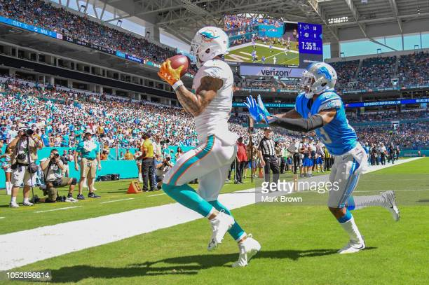 Kenny Stills of the Miami Dolphins scores a touchdown in the second quarter against the Detroit Lions at Hard Rock Stadium on October 21, 2018 in...