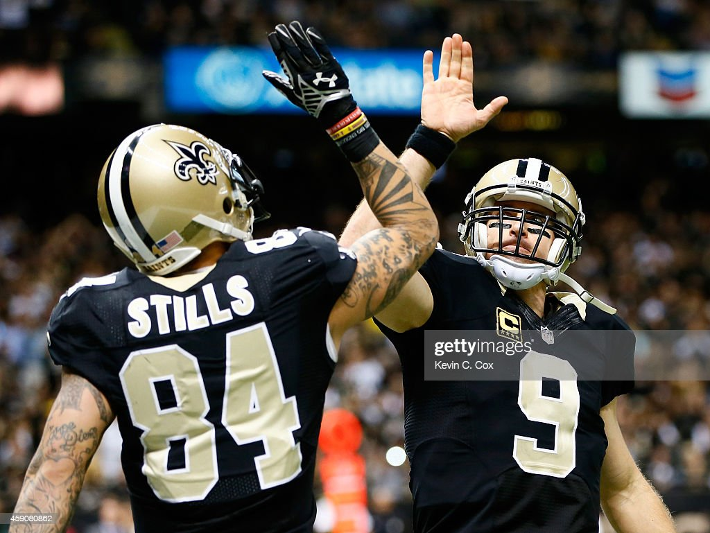 Kenny Stills #84 of the New Orleans Saints and Drew Brees #9 celebrate a touchdown during the second half against the New Orleans Saints at Mercedes-Benz Superdome on November 16, 2014 in New Orleans, Louisiana.
