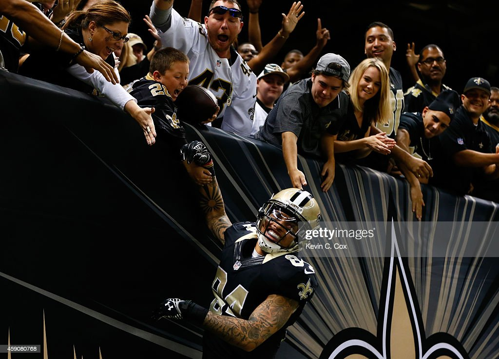 Kenny Stills #84 of the New Orleans Saints celebrates with fans after his touchdown against the Cincinnati Bengals during the second half at Mercedes-Benz Superdome on November 16, 2014 in New Orleans, Louisiana.