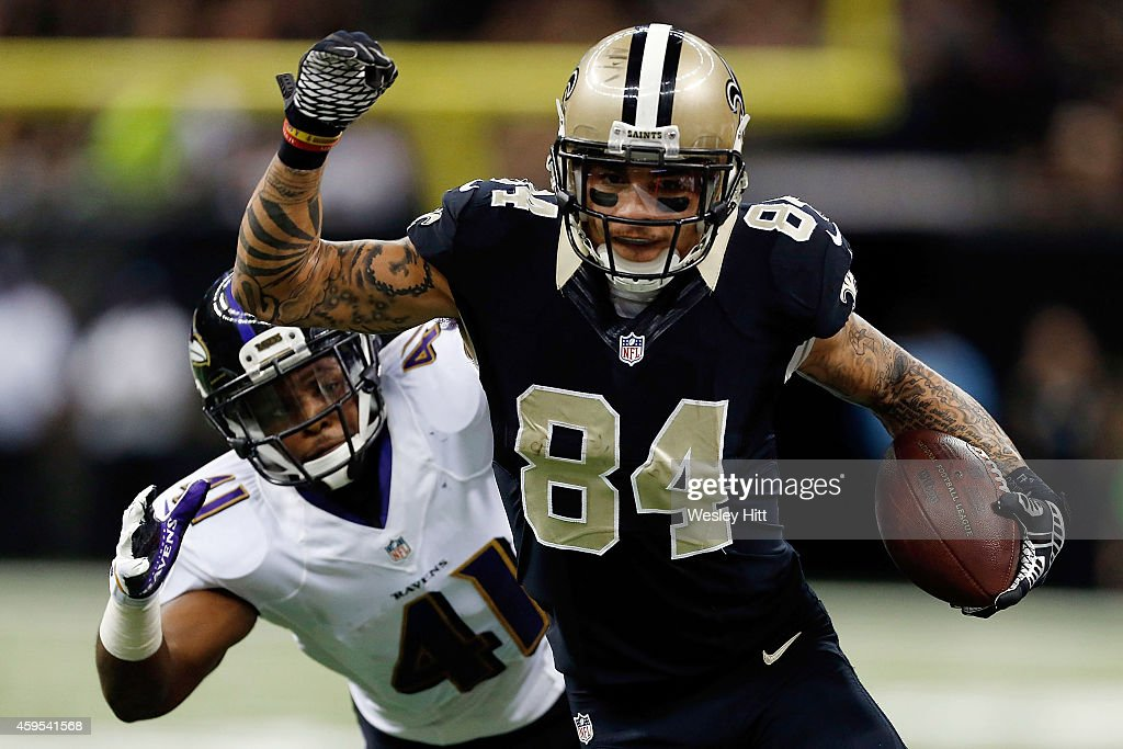 Kenny Stills #84 of the New Orleans Saints is pursued by Anthony Levine #41 of the Baltimore Ravens during the second quarter of a game at the Mercedes-Benz Superdome on November 24, 2014 in New Orleans, Louisiana.