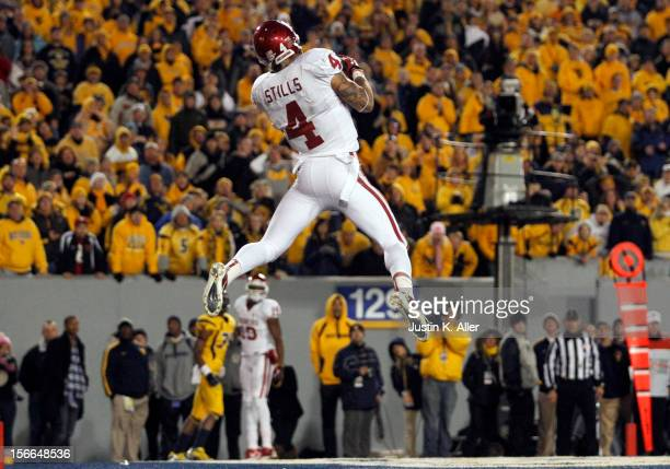 Kenny Stills of the Oklahoma Sooners catches a touchdown pass in the second half against the West Virginia Mountaineers during the game on November...
