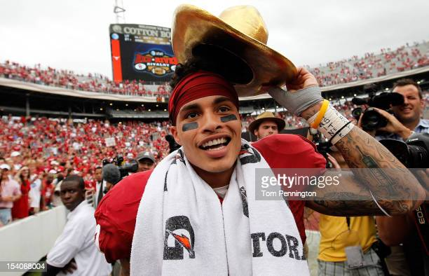Kenny Stills of the Oklahoma Sooners celebrates with the ATT Red River Rivalry trophy after the Oklahoma Sooners beat the Texas Longhorns 6321 at...