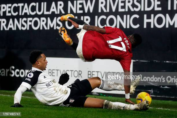 Kenny Tete of Fulham tackles Fred of Manchester United during the Premier League match between Fulham and Manchester United at Craven Cottage on...
