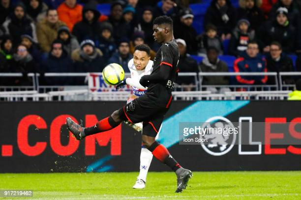 Kenny Tete of Lyon and Ismaila Sarr of Rennes during the Ligue 1 match between Olympique Lyonnais and Stade Rennes at Parc Olympique on February 11...