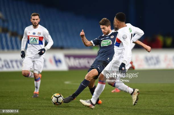 Kenny Tete of Lyon and Paul Lasne of Montpellier during the French Cup match between Montpellier and Lyon at Stade de la Mosson on February 7 2018 in...