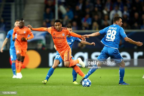 Kenny Tete of Olympique Lyonnais is challenged by Adam Szalai of 1899 Hoffenheim during the Group F match of the UEFA Champions League between TSG...