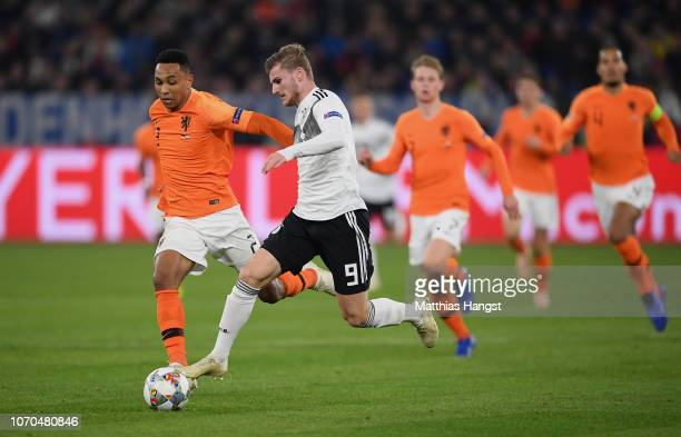 Kenny Tete of The Netherlands ad Timo Werner of Germany compete for the ball during the UEFA Nations League A group one match between Germany and...