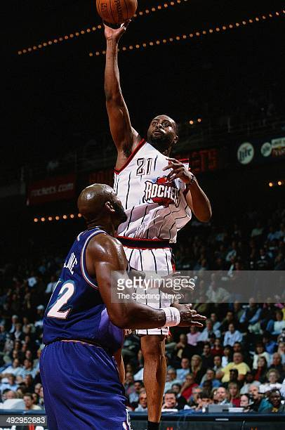 Kenny Thomas of the Houston Rockets goes up for a shot over Karl Malone of the Utah Jazz during the game on March 27 2001 at the Compaq Center in...