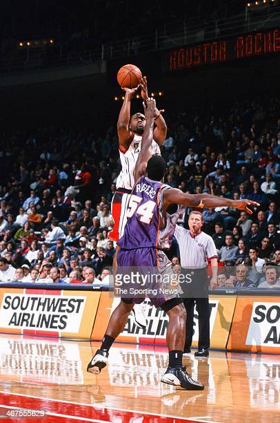 Kenny Thomas of the Houston Rockets takes a jump shot against Rodney Rogers of the Phoenix Suns during the game on November 18 2000 at Compaq Center...