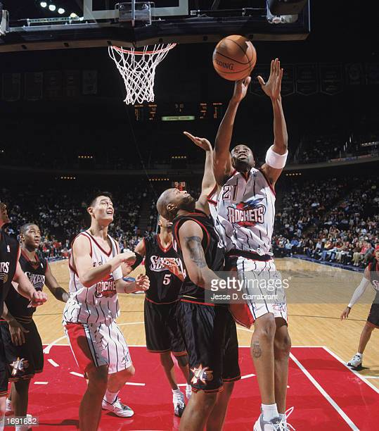 Kenny Thomas of the Houston Rockets takes a shot over Derrick Coleman of the Philadelphia 76ers at COMPAC Center on December 7, 2002 in Houston,...