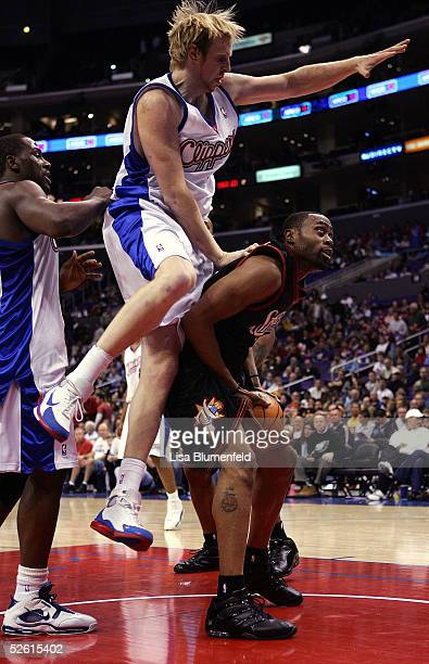 Kenny Thomas of the Philadelphia 76ers attempts to shoot from under the basket against Chris Kaman of the Los Angeles Clippers during the game on...