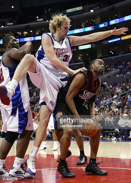 Kenny Thomas of the Philadelphia 76ers tries to get to the basket under pressure from Chris Kaman of the Los Angeles Clippers on January 2 2005 at...