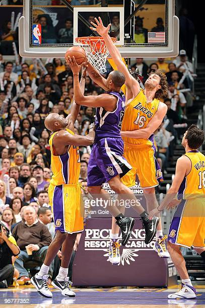 Kenny Thomas of the Sacramento Kings goes to the basket against Lamar Odom and Pau Gasol of the Los Angeles Lakers during the game on January 1 2010...