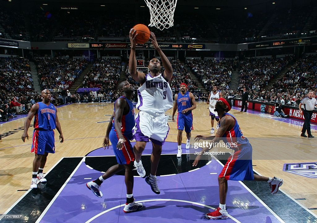 Kenny Thomas #9 of the Sacramento Kings rebounds the ball over Jason Maxiell #54 and Richard Hamilton #32 of the Detroit Pistons during an NBA game at Arco Arena on November 8, 2006 in Sacramento, California.