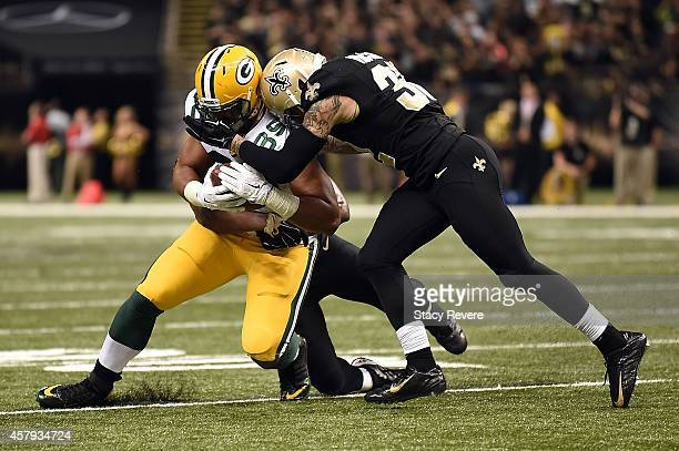 Kenny Vaccaro of the New Orleans Saints brings down Richard Rodgers of the Green Bay Packers during the fourth quarter of a game at MercedesBenz...