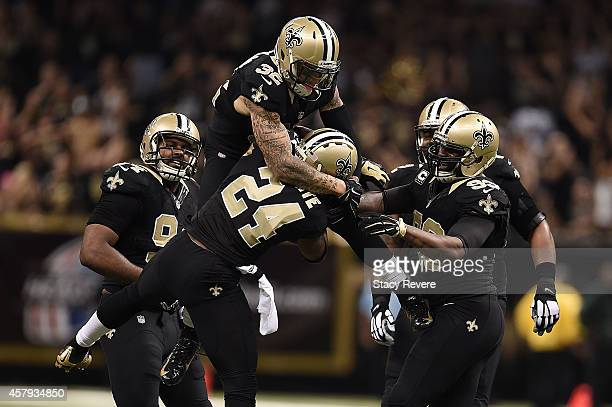 Kenny Vaccaro of the New Orleans Saints celebrates an interception by Corey White during a game against the Green Bay Packers at the MercedesBenz...