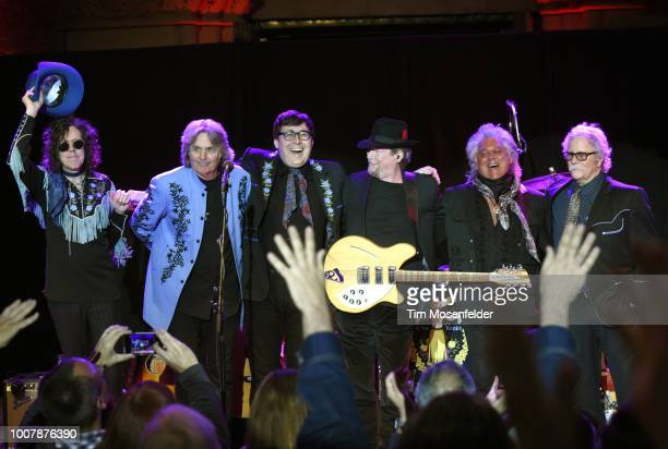 Kenny Vaughan, Harry Stinson, Chris Scruggs, Roger McGuinn, Marty Stuart, and Chris Hillmam perform during the Sweetheart of the Rodeo Reunion at The...
