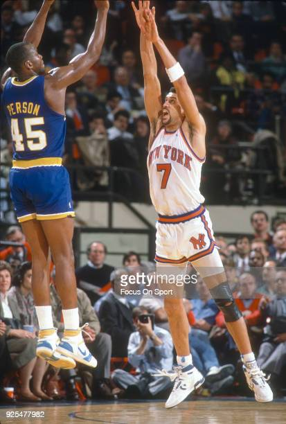 Kenny Walker of the New York Knicks defends the shot of Chuck Person of the Indiana Pacers during an NBA basketball game circa 1990 at Madison Square...