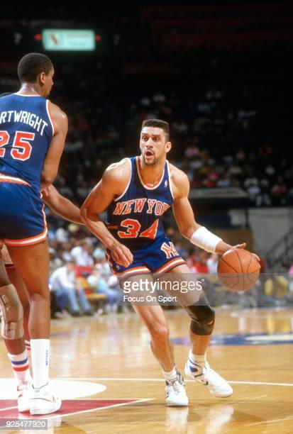 Kenny Walker of the New York Knicks dribbles the ball against the Washington Bullets during an NBA basketball game circa 1988 at the Capital Centre...