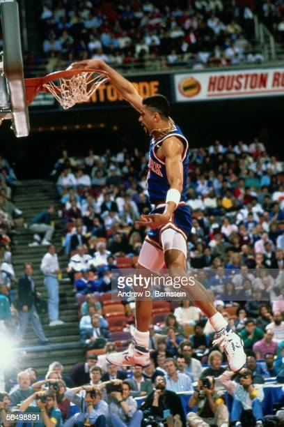 Kenny Walker of the New York Knicks dunks during the Gatorade SlamDunk Competition during the 1989 NBA AllStar Weekend at the Houston Astrodome on...