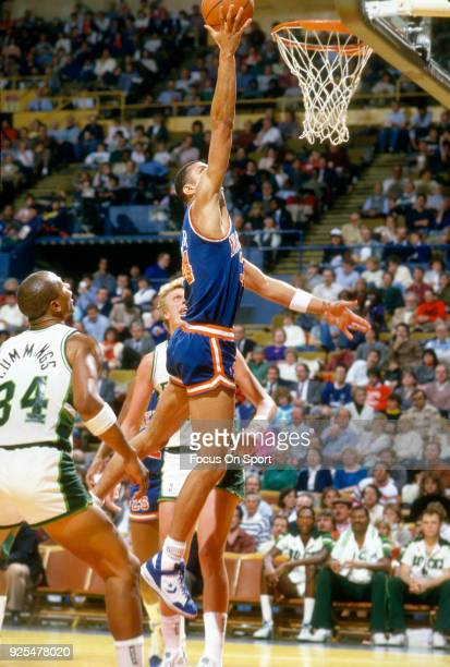 Kenny Walker of the New York Knicks goes in for a layup against the Milwaukee Bucks during an NBA basketball game circa 1989 at the Bradley Center in...