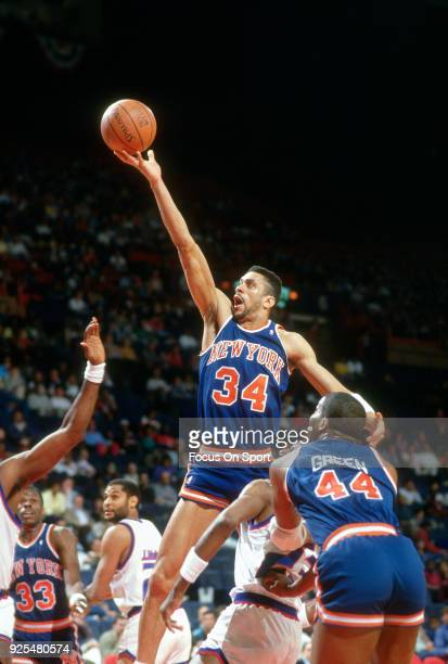 Kenny Walker of the New York Knicks goes in for a layup against the Washington Bullets during an NBA basketball game circa 1988 at the Capital Centre...