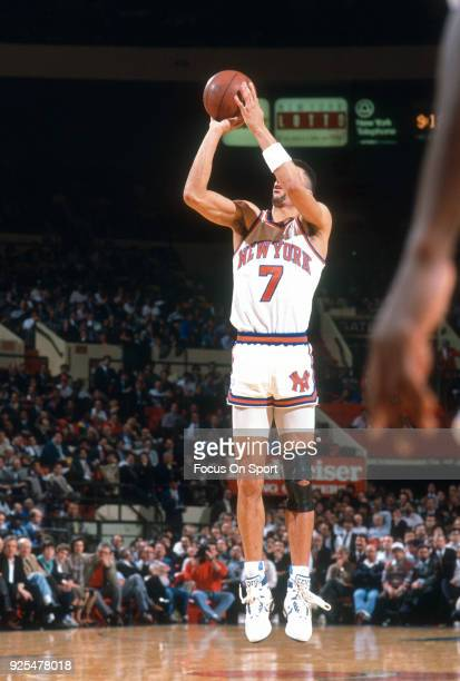 Kenny Walker of the New York Knicks shoots against the Indiana Pacers during an NBA basketball game circa 1990 at Madison Square Garden in the...