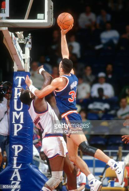 Kenny Walker of the New York Knicks shoots over Moses Malone of the Washington Bullets during an NBA basketball game circa 1988 at the Capital Centre...