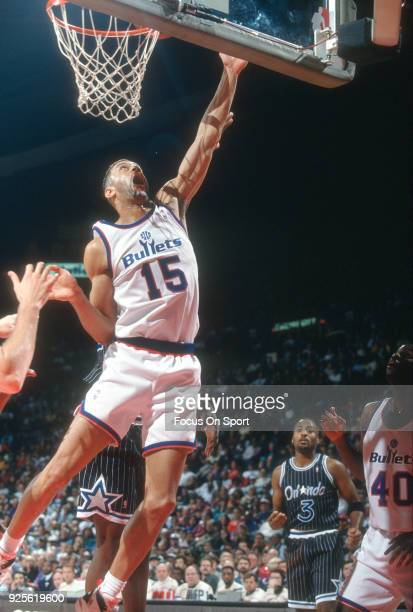 Kenny Walker of the Washington Bullets goes in for a layup against the Orlando Magic during an NBA basketball game circa 1993 at the US Airways Arena...