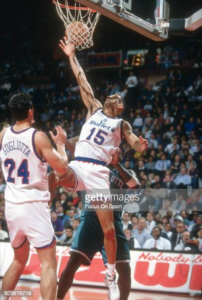 Kenny Walker of the Washington Bullets goes up to grab a rebound against the Charlotte Hornets during an NBA basketball game circa 1993 at the US...