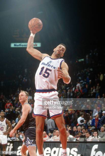 Kenny Walker of the Washington Bullets grabs a rebound against the Orland Magic during an NBA basketball game circa 1993 at the US Airways Arena in...