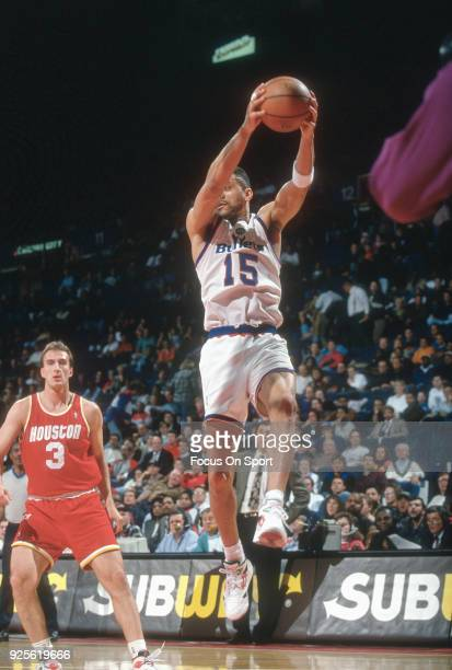 Kenny Walker of the Washington Bullets grabs a rebound against the Houston Rockets during an NBA basketball game circa 1993 at the US Airways Arena...