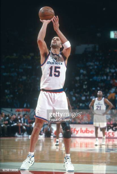 Kenny Walker of the Washington Bullets shoots a free throw during an NBA basketball game circa 1993 at the US Airways Arena in Landover Maryland...
