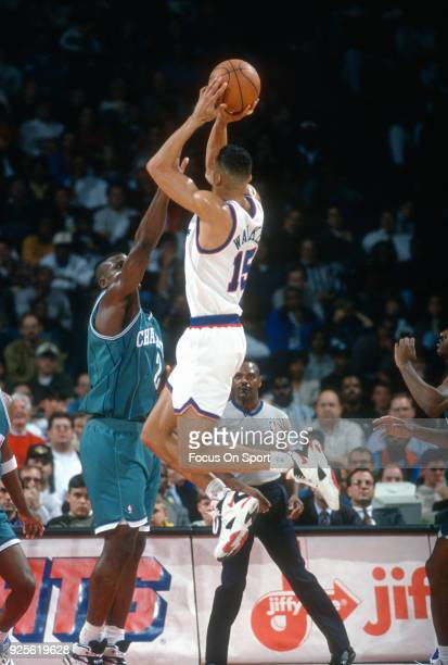 Kenny Walker of the Washington Bullets shoots over Larry Johnson of the Charlotte Hornets during an NBA basketball game circa 1993 at the US Airways...