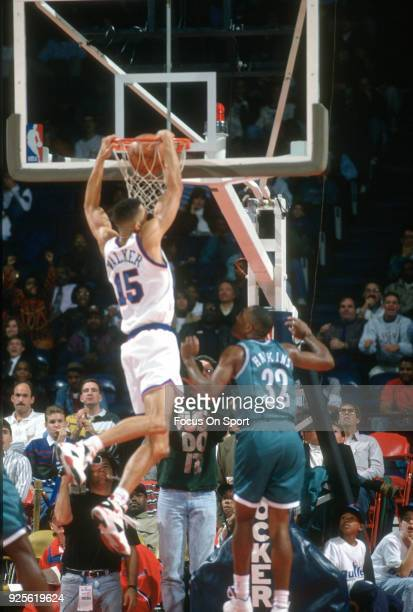 Kenny Walker of the Washington Bullets slam dunks against the Charlotte Hornets during an NBA basketball game circa 1993 at the US Airways Arena in...