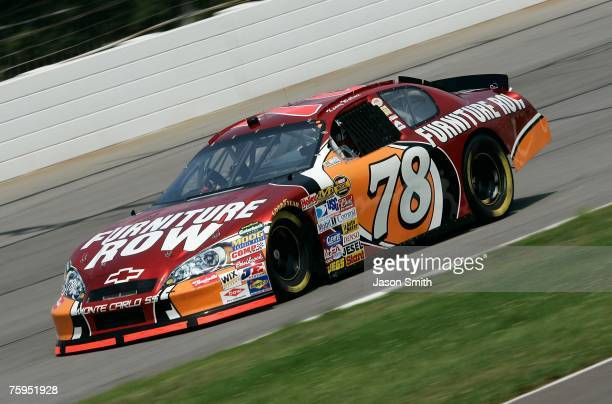 Kenny Wallace driver of the Furniture Row Chevrolet drives during practice for the NASCAR Nextel Cup Series Pennsylvania 500 at Pocono Raceway on...