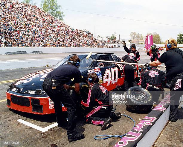 Kenny Wallace makes a pit stop in his Felix Sabates Dirt Devil Pontiac Gran Prix during a NASCAR Cup race at Martinsville Speedway