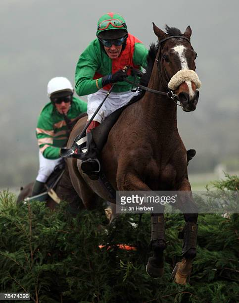 Kenny Whelan and Wonderkid clear the last fence before landing The BGC Cross Country Handicap Steeple Chase Race run at Cheltenham Racecourse on...