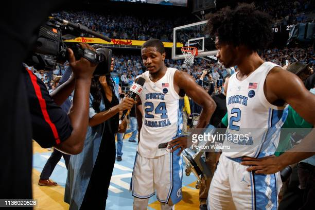 Kenny Williams and Coby White of the North Carolina Tar Heels speak to Maria Taylor of ESPN after a game against the Duke Blue Devils on March 09...