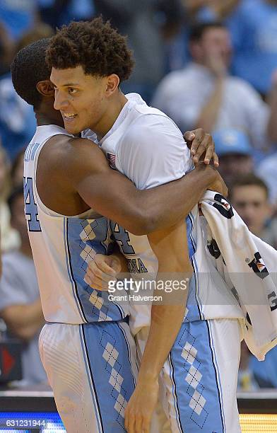 Kenny Williams hugs Justin Jackson of the North Carolina Tar Heels during the game against the North Carolina State Wolfpack at the Dean Smith Center...