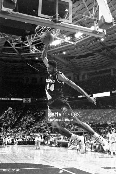 Kenny Williams of the Indiana Pacers attempts a dunk during the 1991 NBA Slam Dunk Contest as part of NBA All Star Weekend on February 9 1991 at the...
